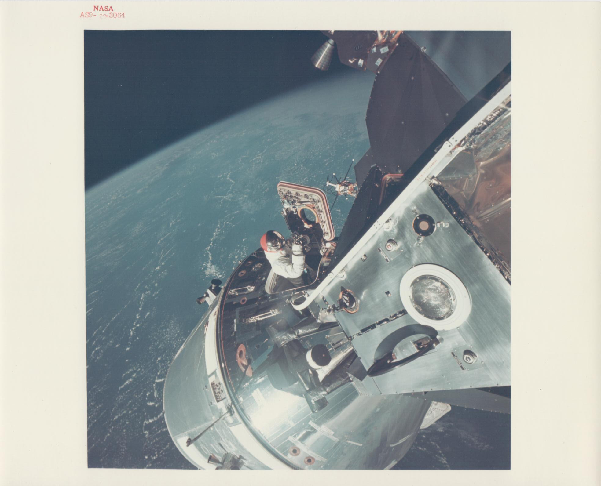 David Scott climbs out of the Command Module, Apollo 9, March 1969
