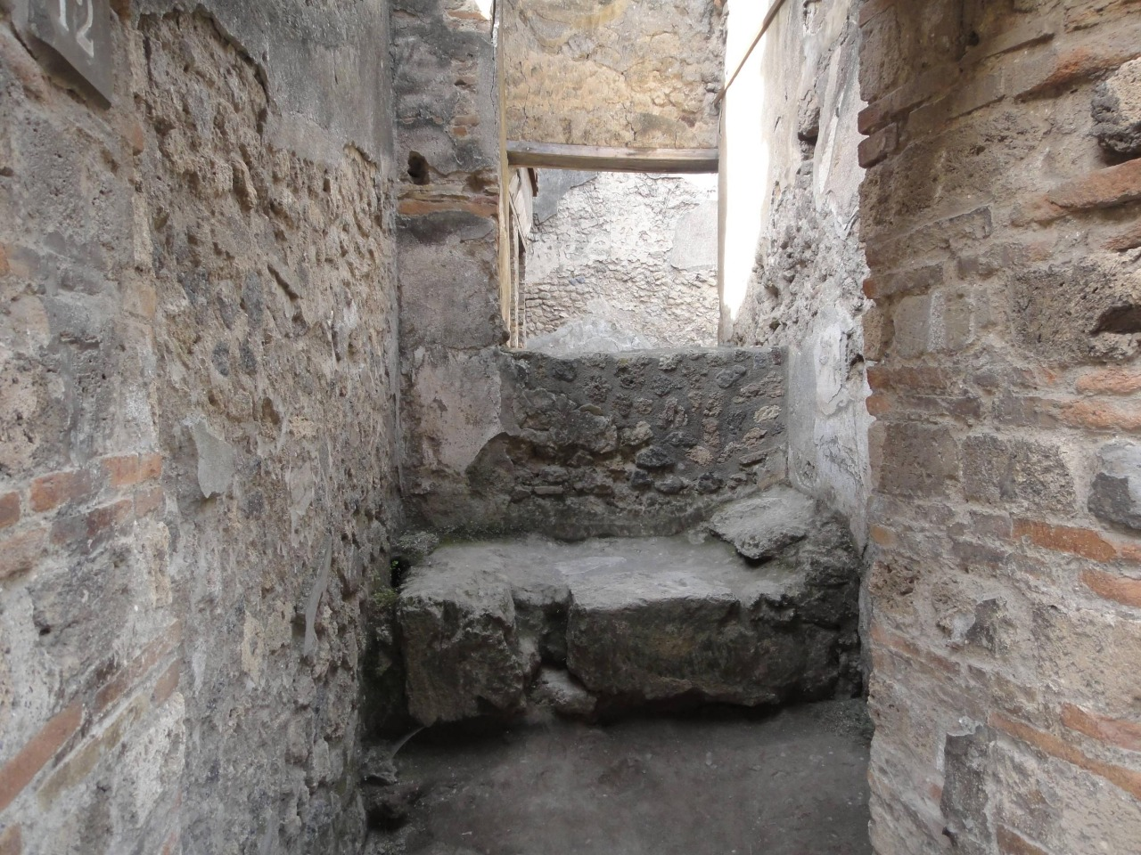 Carved stone bed in Roman brothel (Lupanar) in Pompeii, 79 AD